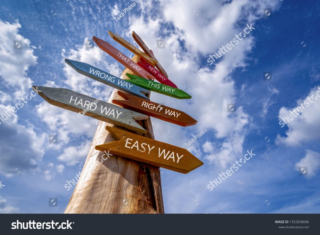 stock-photo-crossroad-signpost-saying-hard-way-easy-way-wrong-way-right-way-and-many-other-ways-decision-1352838686